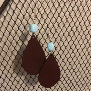 Genuine brown leather dangle earrings.